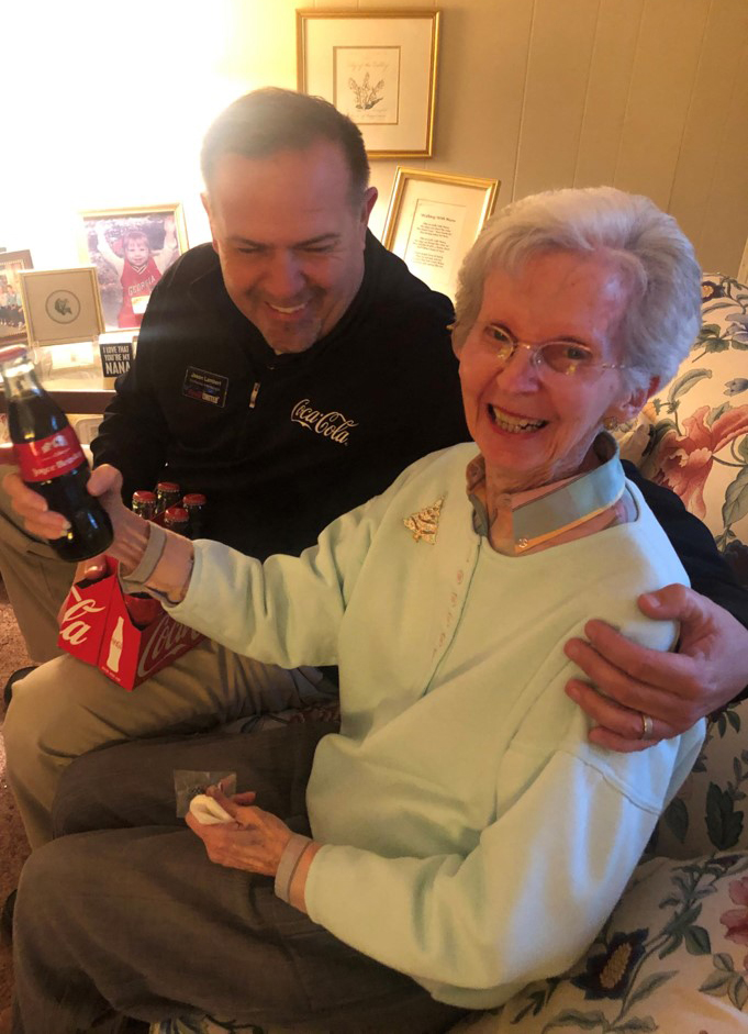 Jason Lambert with Joyce Beasley holding her personalized glass bottle