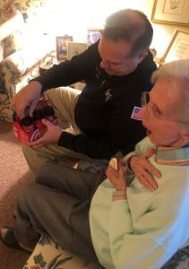 Jason Lambert presenting Joyce with her personalized bottles