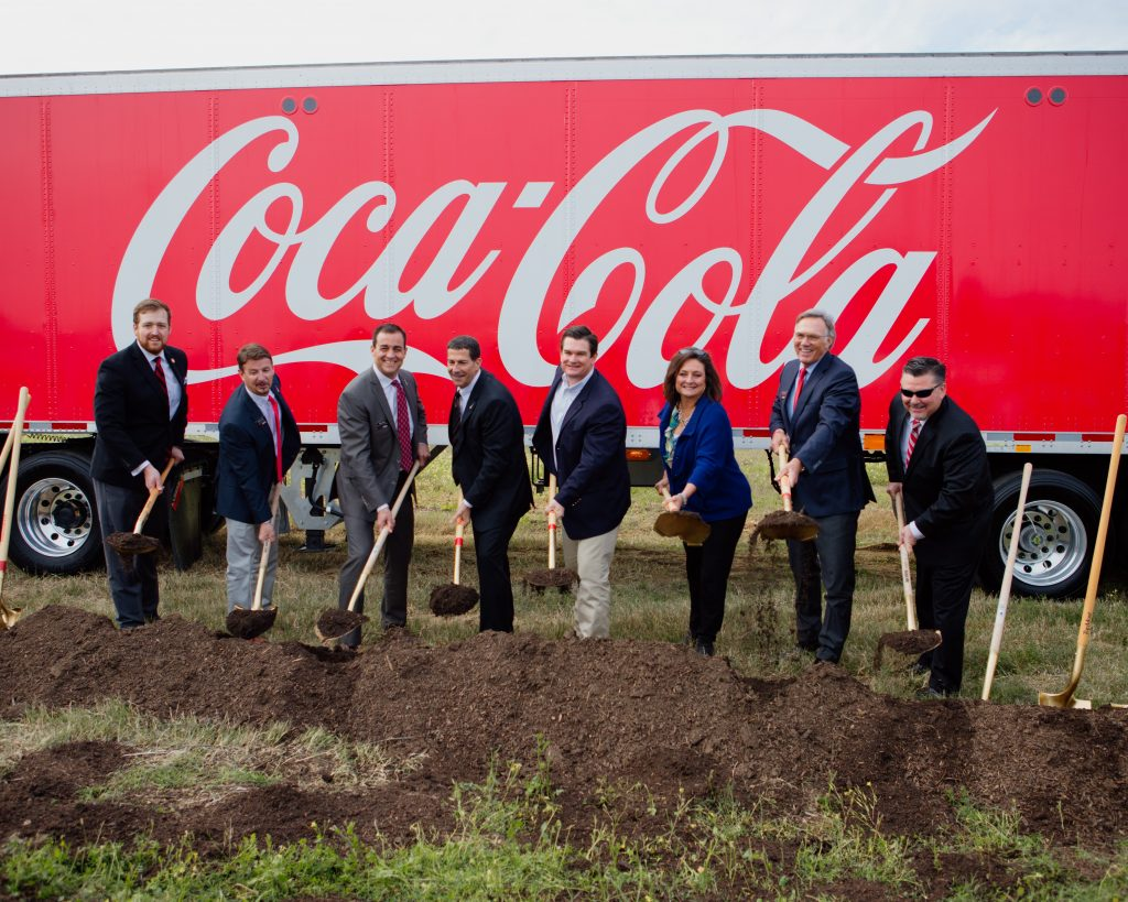 executives with shovels