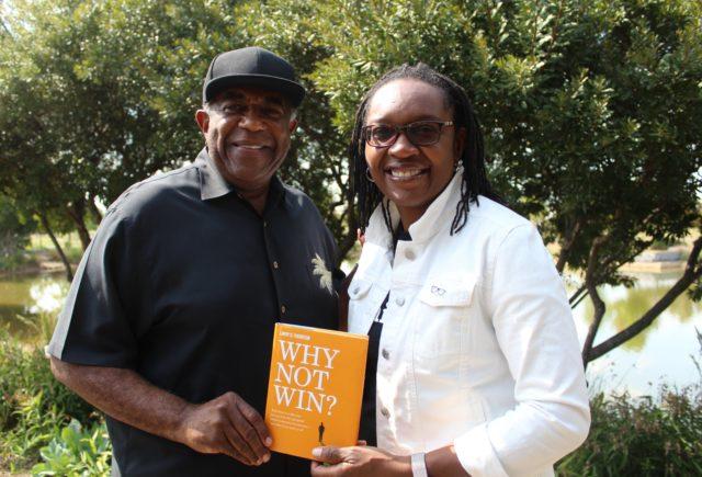 Larry Thornton and Zillah Fluker holding Larry's book